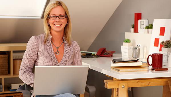 bigstock-Happy-woman-holding-laptop-com-76256012