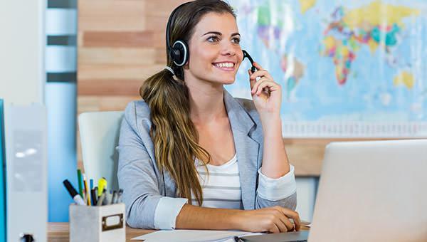 bigstock-Pretty-travel-agent-speaking-t-93647012