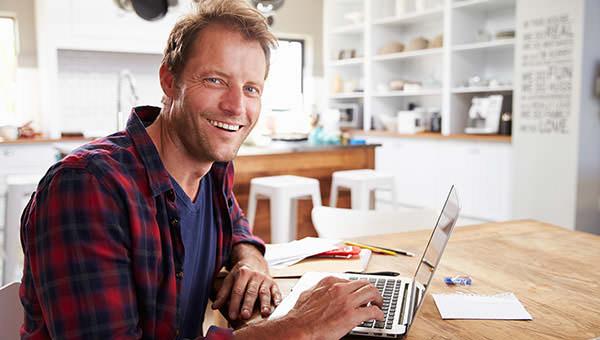bigstock-Man-working-on-laptop-at-home-92385767